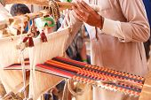 image of nomads  - A man produces the fabric on a traditional loom in the Bedouin village Egypt - JPG