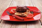 image of wood pieces  - grilled beef fillet pieces on noodles  - JPG