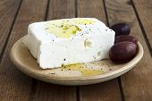 picture of kalamata olives  - Greek feta cheese oil kalamata olives on rustic plate board - JPG