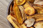 image of parsnips  - Detail of fried carrot and parsnip chips in rustic wood bowl - JPG