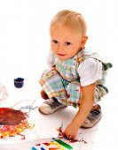 foto of finger-painting  - Little boy painting by finger paint - JPG