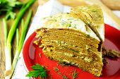 foto of liver  - Liver pie two pieces on a plate with fresh herbs - JPG