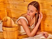 foto of sauna woman  - Young woman with closed eyes lying in sauna - JPG