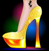pic of platform shoes  - dark festive background and the ladys foot in the golden shoe - JPG