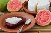 picture of juliet  - Brazilian dessert Romeo and Juliet of goiabada and Minas cheese with fresh goiaba on wooden table - JPG