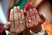picture of indian wedding  - The wedding rings on the hands of an Indian bride and groom - JPG