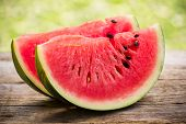 picture of watermelon slices  - Fresh watermelon slices on the wooden table - JPG