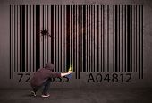 foto of barcode  - Young urban painter drawing a barcode on the wall - JPG