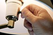 stock photo of turn-up  - Horizontal close up shot of hand switching or turning on the light - JPG
