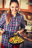 picture of frozen food  - Woman in kitchen cooking stir fry frozen vegetables - JPG