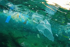 stock photo of polluted  - Environmental problem of plastic rubbish pollution in ocean - JPG