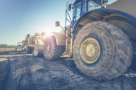stock photo of bulldozers  - Digger bulldozer on construction site - JPG