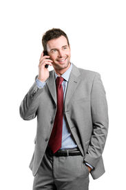 foto of mobile-phone  - Young smiling businessman talking on mobile isolated on white background - JPG