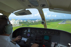 pic of san juan puerto rico  - Pilot is getting ready for landing overlooking the city ocean beach and landing strip on the background.