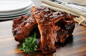 foto of baby back ribs  - A close up photo of barbecued baby back ribs - JPG