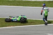 SEPANG, MALAYSIA - OCTOBER 21: Moto2 rider Kenan Sofuoglu reacts after a fall at turn 15 during free