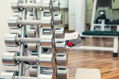 Rows Of Metal Heavy Dumbbells On Stand In Sport Gym, Physiotherapy Clinic. Physical Therapy Center.  poster