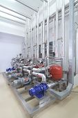 stock photo of vacuum pump  - Modern machinery in a pharmaceutical production plant - JPG