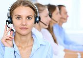 Call Center Operator In Headset While Consulting Client. Telemarketing Or Phone Sales. poster