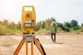 Surveyor Engineer Making Measure At The Land poster