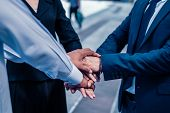 Businessman And Businesswoman Shaking Hands For Demonstrating Their Agreement To Sign Agreement Or C poster