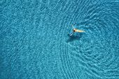 Aerial View Of Swimming Woman In The Sea At Sunset In Maldives. Aerial Seascape With Young Girl, Cle poster