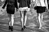 Epilation Of The Legs. Female Legs Of Three Young Girls On High Heels Walking In Street Sunny Day Wi poster