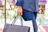 Fashion Shopping Girl Portrait. Beauty Woman With Shopping Bags In Shopping Mall. Shopper. Sales. Sh poster