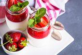 Panna Cotta With Strawberry Jam. Sweet Dessert From Whipped Cream With Strawberry Jam And Fresh Stra poster