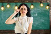 Woman With Long Hair In White Blouse Stands In Classroom. Strict Teacher Concept. Lady Strict Teache poster