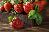 Fresh Juicy Strawberries With Leaves. Strawberry Background. Healthy Food Concept. Fresh Organic Ber poster