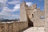 foto of apennines  - ruins of ancient fortification in barren landscape of apennine high mountains - JPG