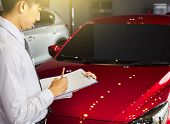 Career Man Saleman Business Inspection Writing On Notepad Or Book,  Paper With Car Blurry Background poster