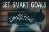 Text Sign Showing Set Smart Goals. Conceptual Photo Giving Criteria To Guide In The Setting Of Objec poster