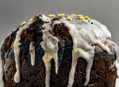 Rustic Brown Biscuit Cake With Icing On A Gray Background. Glaze Flows Down White Smudges With Color poster