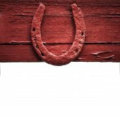 foto of arch foot  - The old horseshoe hanging on wooden wall on a white background - JPG