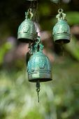 foto of buddhist  - Copper bells in Buddhist place of worship in Phuket - JPG