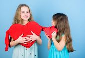 Loving Sister. Sincere Kids Share Tenderness And Love. Girls Hug Red Plush Heart Toy Symbol Love. Si poster