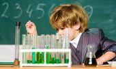 Science Experiments In Lab. Little Boy Is Making Science Experiments. Biology Science. Little Boy At poster