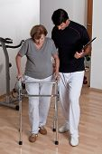 Therapist Helping Patient use Walker.