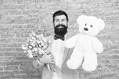 Macho Getting Ready Romantic Date. Man Wear Blue Tuxedo Bow Tie Hold Flowers Bouquet. International  poster