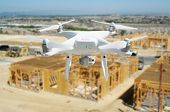 Unmanned Aircraft Quadcopter Drone Flying and Inspecting Construction Site. poster
