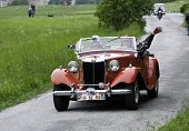 Two ladies driving a old MG