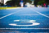 Number Three On The Start Of A Running Track .blue Treadmill With Different Numbers And White Lines. poster