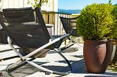 Relax In The Sun. Empty Deck Chairs Outdoor On Veranda. Holiday Cottage. poster