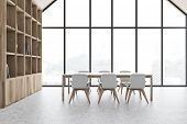 White Attic Dining Room Interior With Bookcase poster