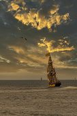 Antique Tall Ship, Vessel Leaving The Harbor Of The Hague, Scheveningen Under A Sunny And Blue Sky poster