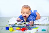 Cute Happy Baby Lying And Playing. Paints. Cute Little Baby Crawling. Creative Concept. Crawling Fun poster