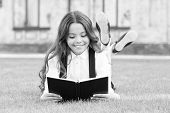 Basic Education. Adorable Little Girl Learn Reading. Schoolgirl School Uniform Laying On Lawn With F poster
