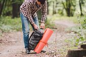 Guy With Backpack, Traveller, Hipster Standing In Woods, Hiking, Forest, Journey. Caucasian Tourist  poster